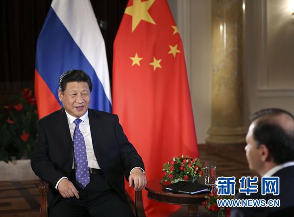 2014年2月7日,习近平在俄罗斯索契接受俄罗斯电视台专访。新华社记者 兰红光摄